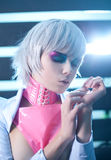 Sensual woman with creative makeup. In sci-fi style latex clothes Stock Photography