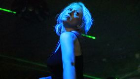 Sensual woman dancing. Sensual modern dance in the dark of a discotheque under green laser strobe lights. Entertainment, leisure and nightlife concept. Adult stock footage