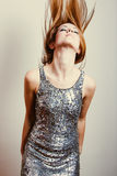 Sensual woman dancing in sequins dress hair up Royalty Free Stock Images