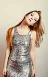 Sensual woman dancing in sequins dress Stock Photography