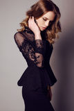 Sensual woman with dark hair in elegant black dress Stock Photography