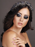 Sensual woman with dark hair with evening makeup and luxurious headband royalty free stock images