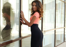 Sensual woman with dark hair and tanned body in elegant dress royalty free stock photography