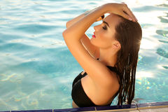 Sensual woman with dark hair wearing elegant bikini Royalty Free Stock Photos