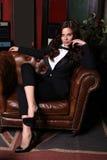 Sensual woman with dark hair wearing elegant black suit Royalty Free Stock Images