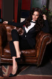 Sensual woman with dark hair wearing elegant black suit Stock Photography