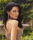 Sensual woman with dark hair wearing luxurious sequin dress Royalty Free Stock Photos