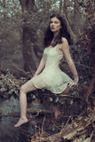 Sensual Woman in Dress Posing at the Woods Royalty Free Stock Photo