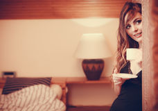 Sensual woman drinking hot coffee beverage at home Royalty Free Stock Photos