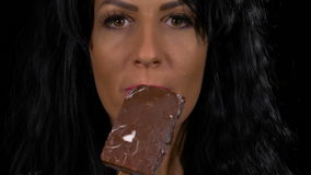 Sensual woman eating a delicious vanilla chocolate topping ice cream. Sensual woman eating a delicious vanilla with chocolate topping ice cream stock footage