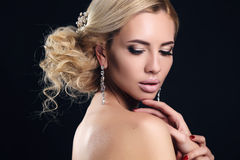 Sensual woman with elegant hairstyle and evening makeup Stock Photos