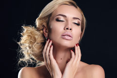 Sensual woman with elegant hairstyle and evening makeup Stock Photography