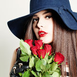 Sensual Woman Fashion Model holding Red Roses. Flowers Stock Image