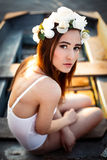 Sensual woman in floral wreath. Sensual sexy woman wearing floral wreath and white lingerie Stock Photo