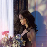 Sensual woman with flowers Stock Image
