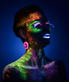 Sensual woman in fluorescent paint makeup Stock Photo