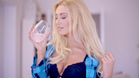 Sensual Woman with Glass of Water Showing Cleavage stock video