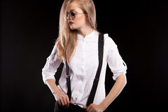 Sensual woman in glasses and suspenders Stock Photo