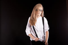 Sensual woman in glasses and suspenders Stock Photography