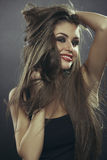 Sensual woman with hands through long hair Stock Photo