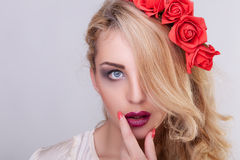 Sensual woman with her hand on the lips Stock Photo