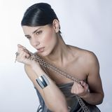 Sensual woman holding métallic chain Royalty Free Stock Photo