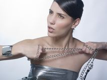 Sensual woman holding métallic chain Royalty Free Stock Photos