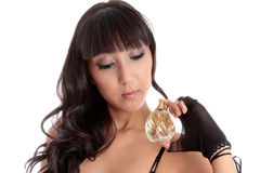 Sensual woman holding perfume Royalty Free Stock Photography