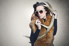 Sensual woman with a horn deer Stock Image