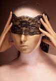 Sensual woman with a lace on face Stock Photography