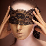Sensual woman with a lace on face Stock Image
