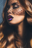 Sensual woman with lace on face and professional make up Stock Photo