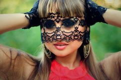 Sensual woman with a lace veil Royalty Free Stock Images
