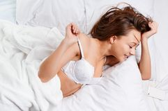 Sensual woman laying in bed Royalty Free Stock Photo