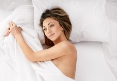 Sensual woman laying in bed Royalty Free Stock Photos