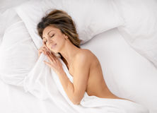 Sensual woman laying in bed Stock Images