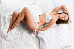 Sensual Woman Laying In Bed Royalty Free Stock Image