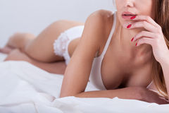 Sensual woman lies and touches her mouth Royalty Free Stock Photo