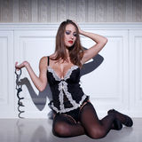 Sensual woman in lingerie holding handcuffs Royalty Free Stock Photos