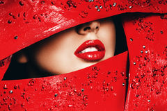 Sensual woman lips in red frame Stock Photos
