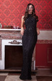Sensual woman in long black dress on red vintage interior Royalty Free Stock Images