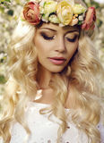 Sensual woman with long blond hair and flower's headband Stock Photo