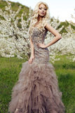 Sensual woman with long blond hair in luxurious sequin dress Stock Photo