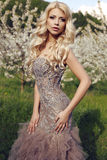 Sensual woman with long blond hair in luxurious sequin dress. Fashion outdoor photo of beautiful sensual woman with long blond hair in luxurious sequin dress Royalty Free Stock Photos