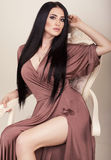 Sensual woman with long dark hair in elegant silk dress Royalty Free Stock Photography