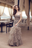 Sensual woman with long dark hair in luxurious sequin dress Royalty Free Stock Image