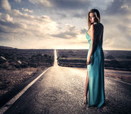 Sensual woman in a long dress Stock Photos