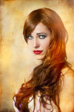 Sensual woman with long red hair. Over vintage background royalty free stock photos