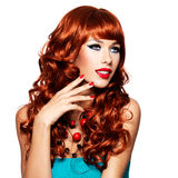 Sensual woman with long red hairs and red nails Stock Photography