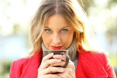 Sensual woman looking at camera with coffee cup Royalty Free Stock Photo